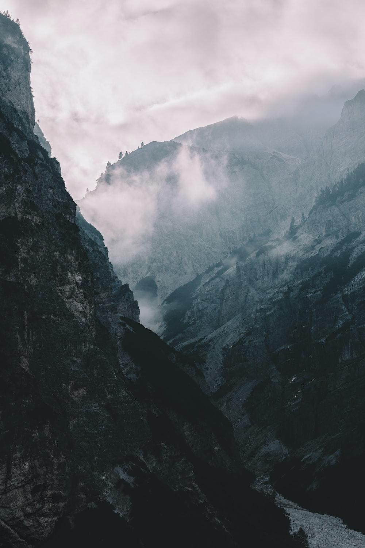black foggy mountain during daytime
