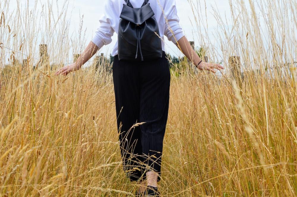person walking on grass field