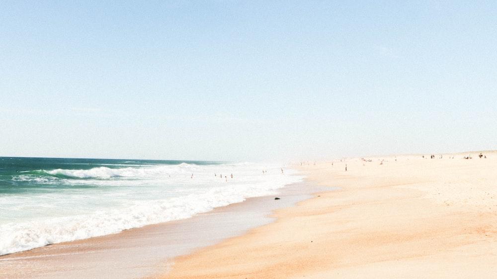 blue ocean under clear blue sky