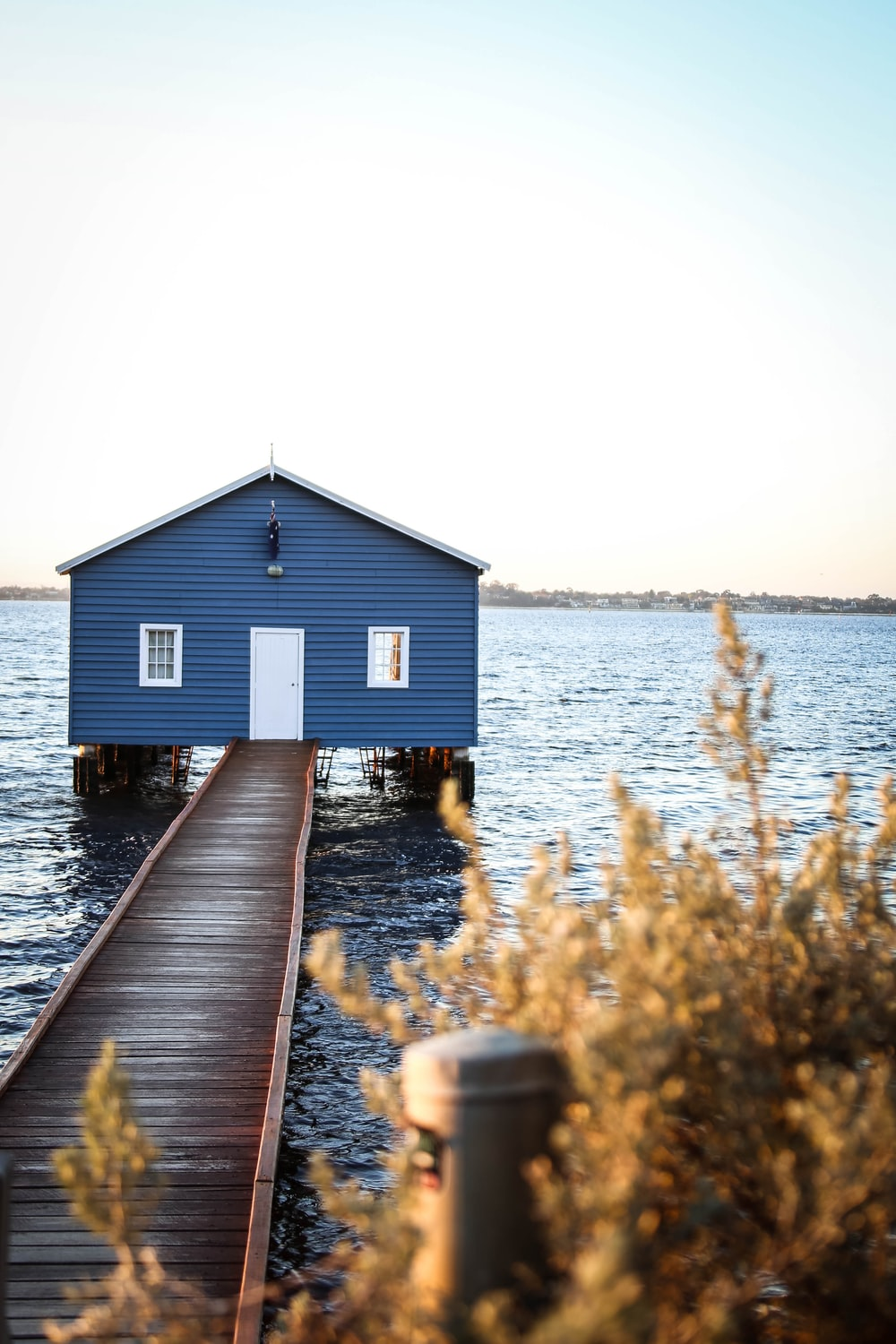 blue house with wooden dock