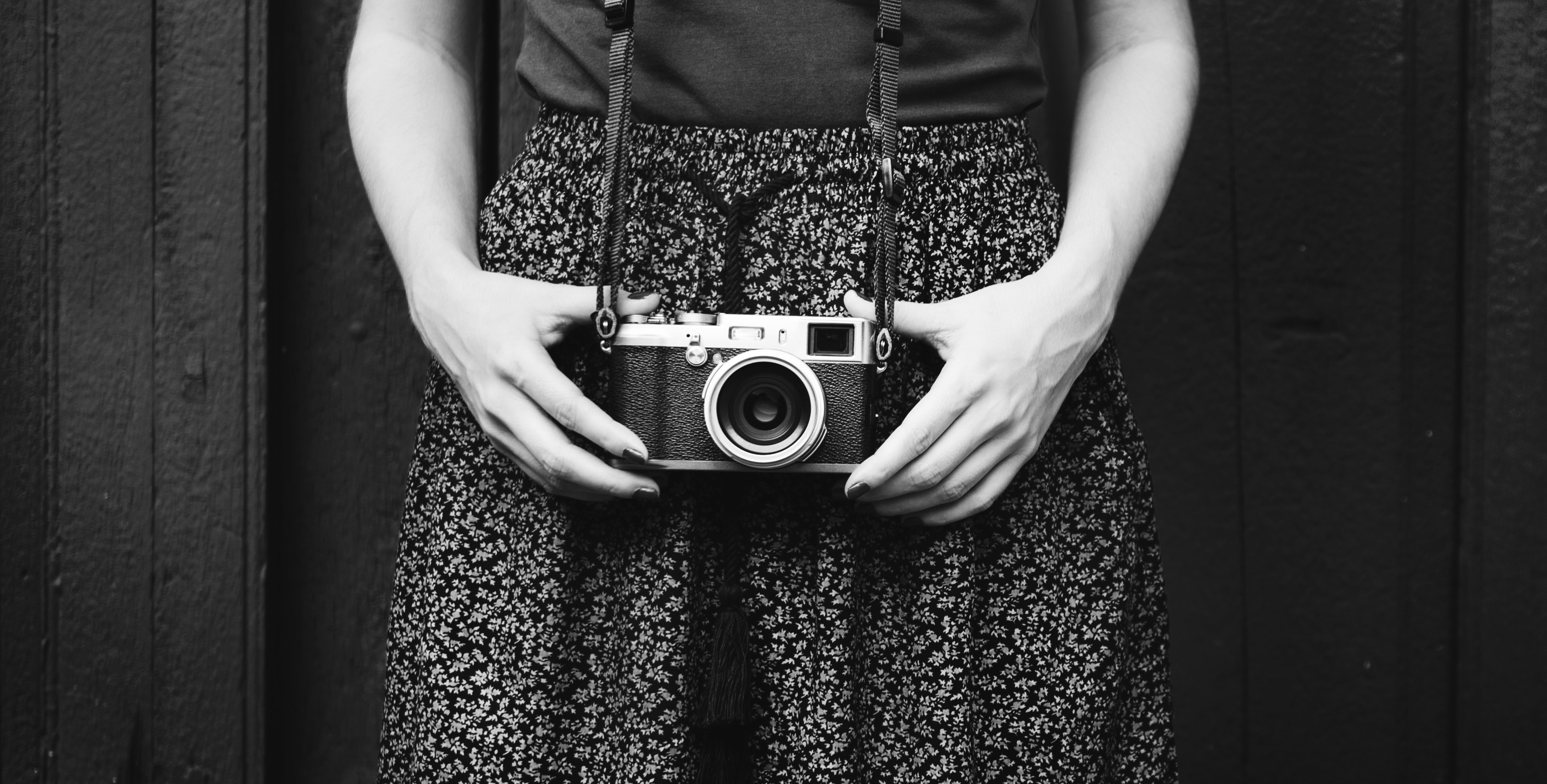 grayscale photography of person holding MILC