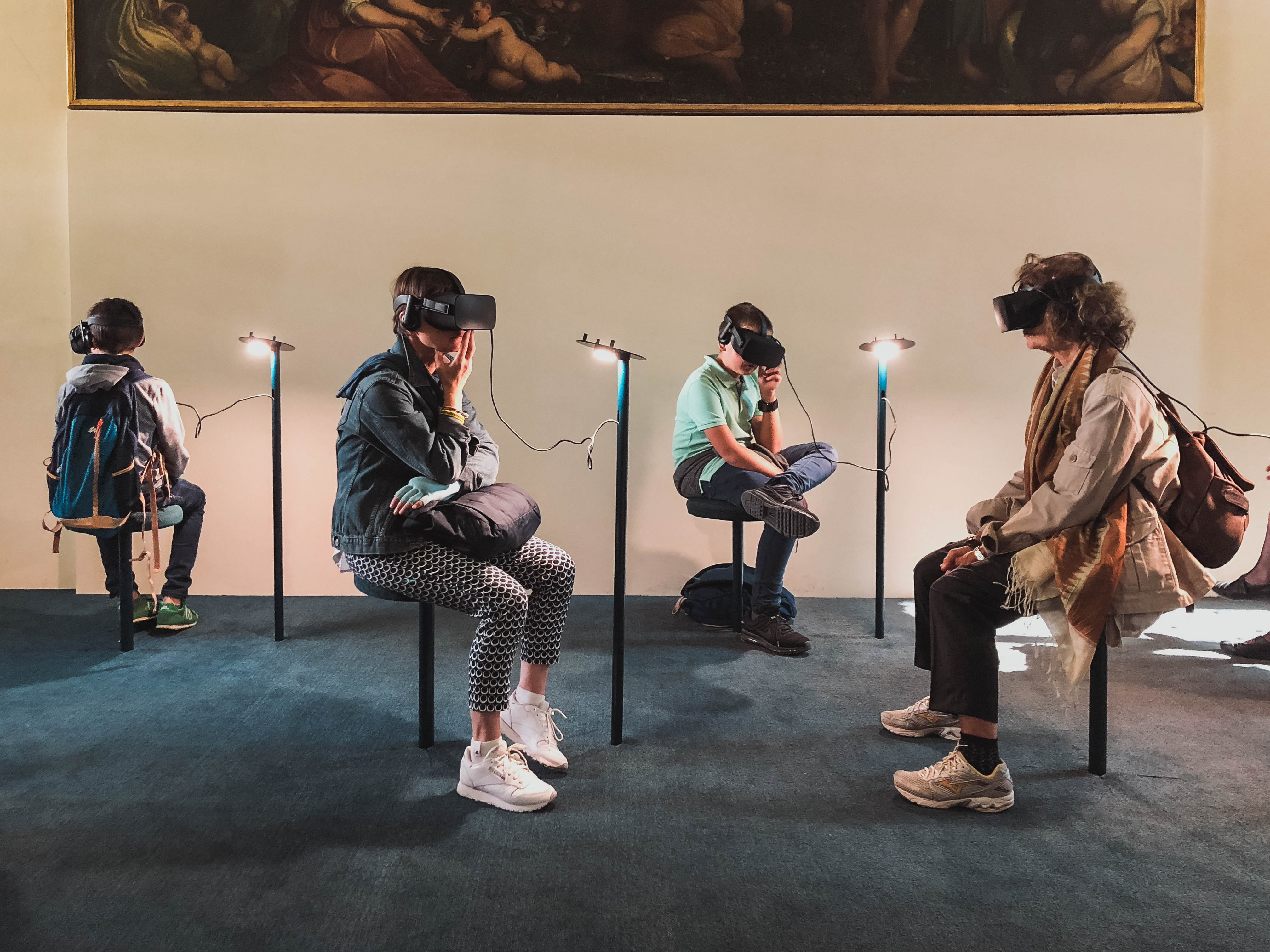four person playing virtual reality goggles