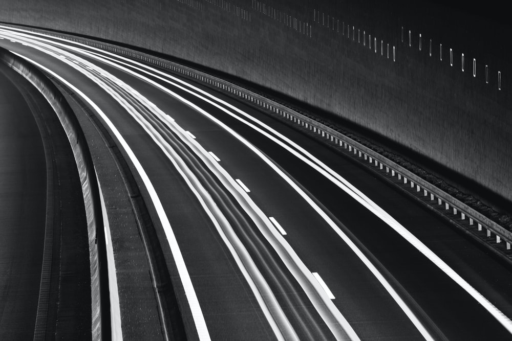 grayscale photo of tunnel
