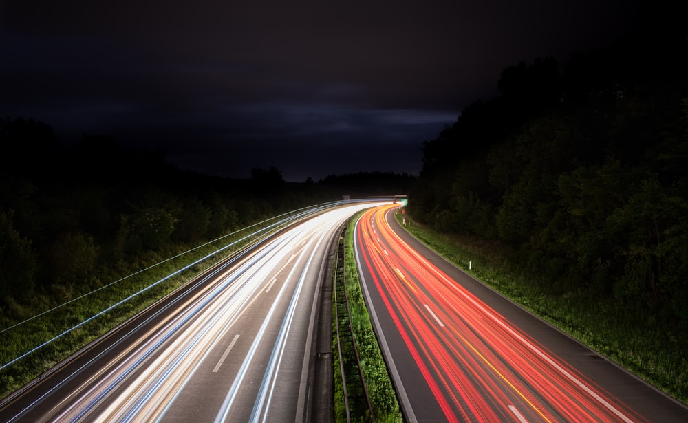 timelapse photography of vehicle tailights in road at night time