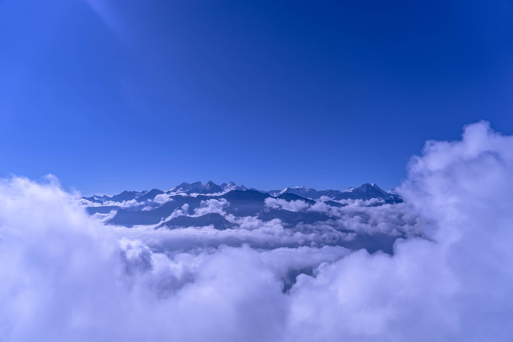 bird's-eye photography of mountains and clouds