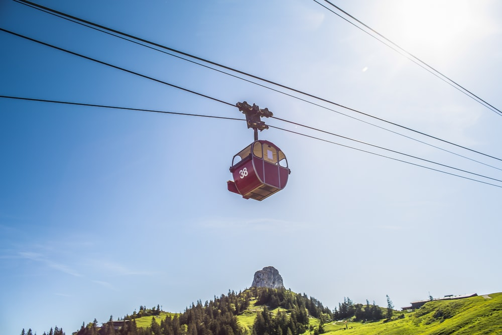 red cable car under sunlight