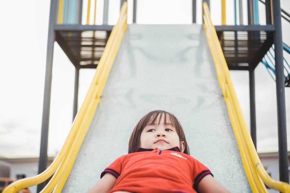 children sliding on slide