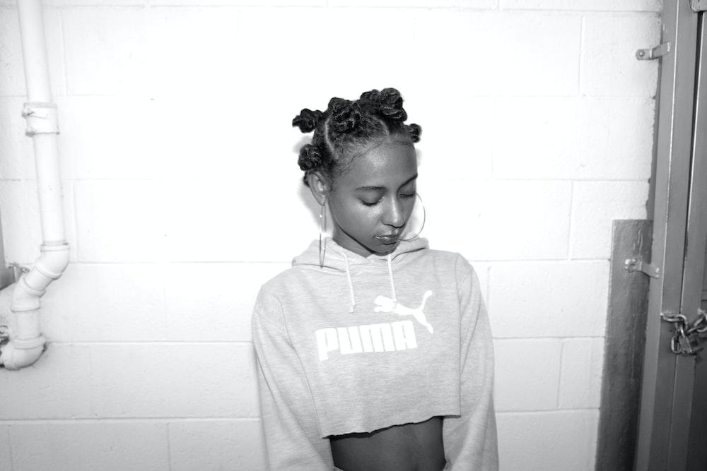 grayscale photography of woman wearing crop top sweatshirt