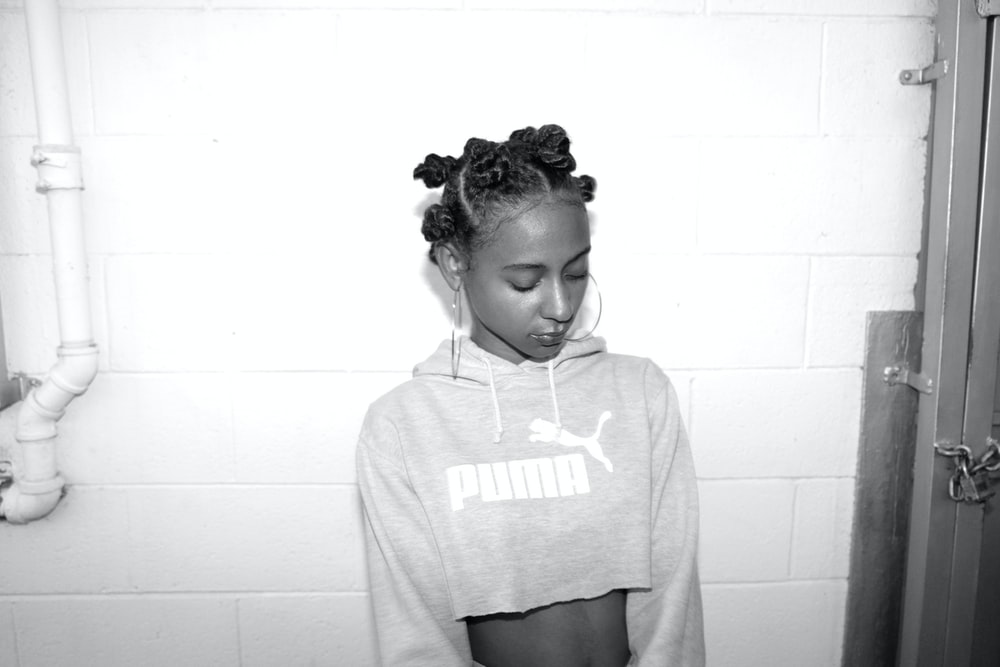 grayscale photography of woman wearing crop top sweatshirt