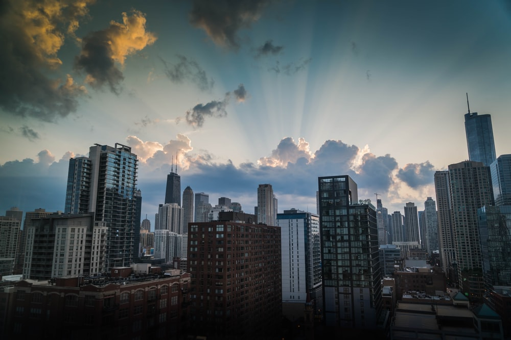 high-rise and mid-rise buildings under cloudy sky