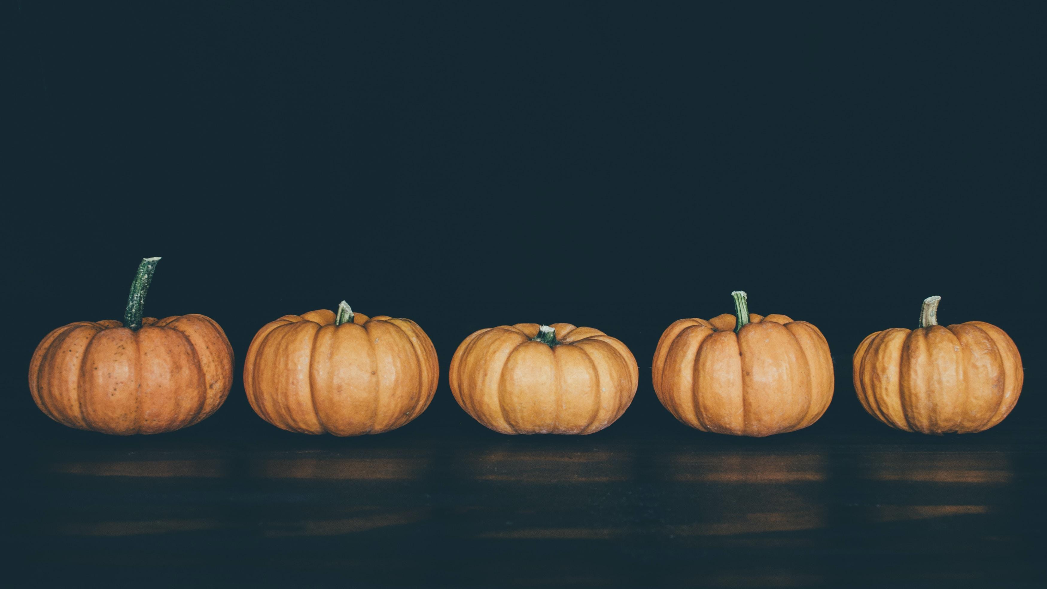five orange pumpkins
