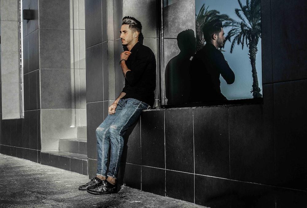 man sitting on concrete bench