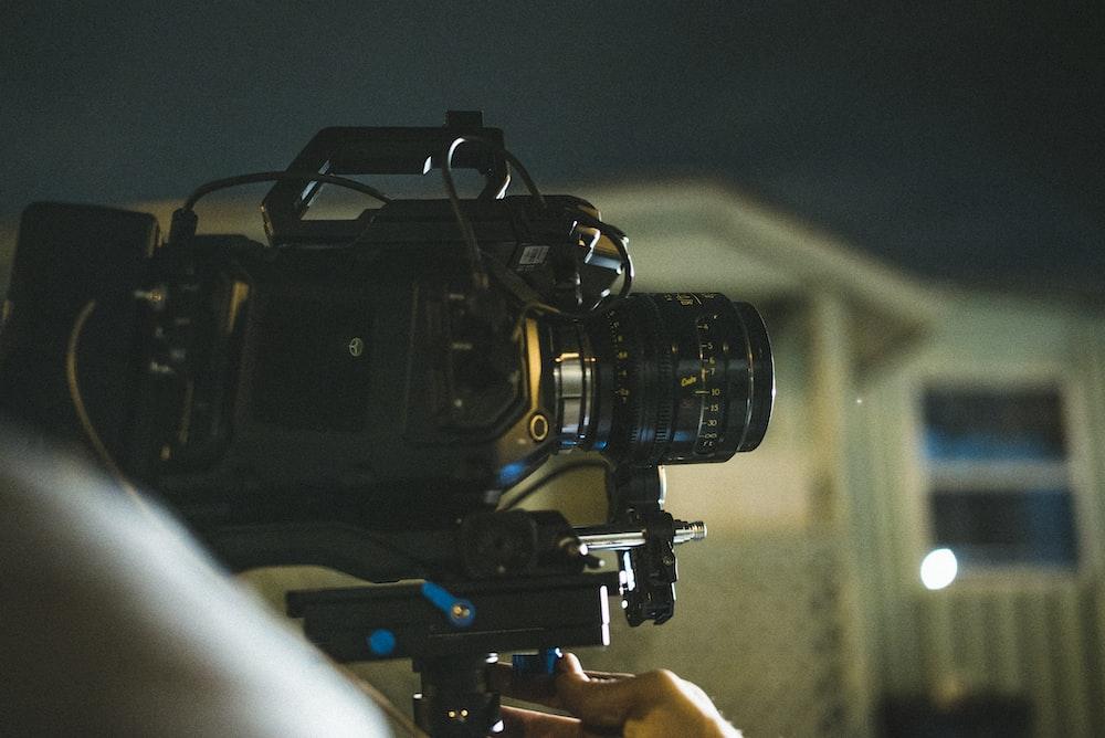 selective focus photography of black DSLR camera