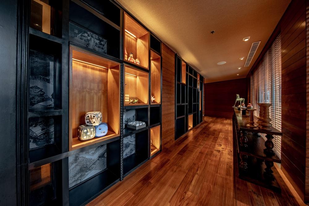 hallway near black and brown shelf