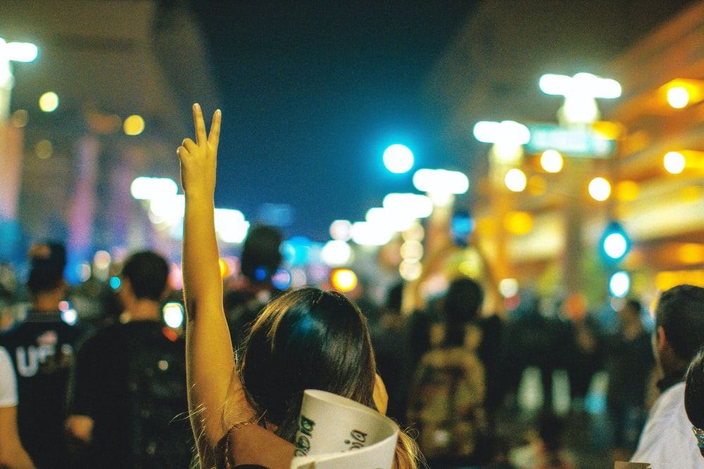 woman raising his hand