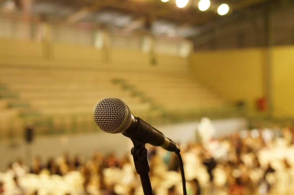 shallow focus photo of black corded microphone
