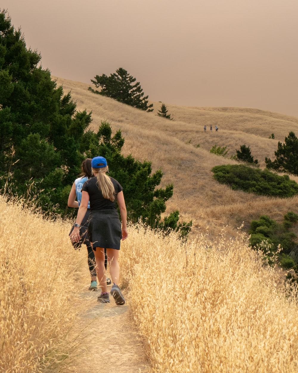 two woman walks outdoor