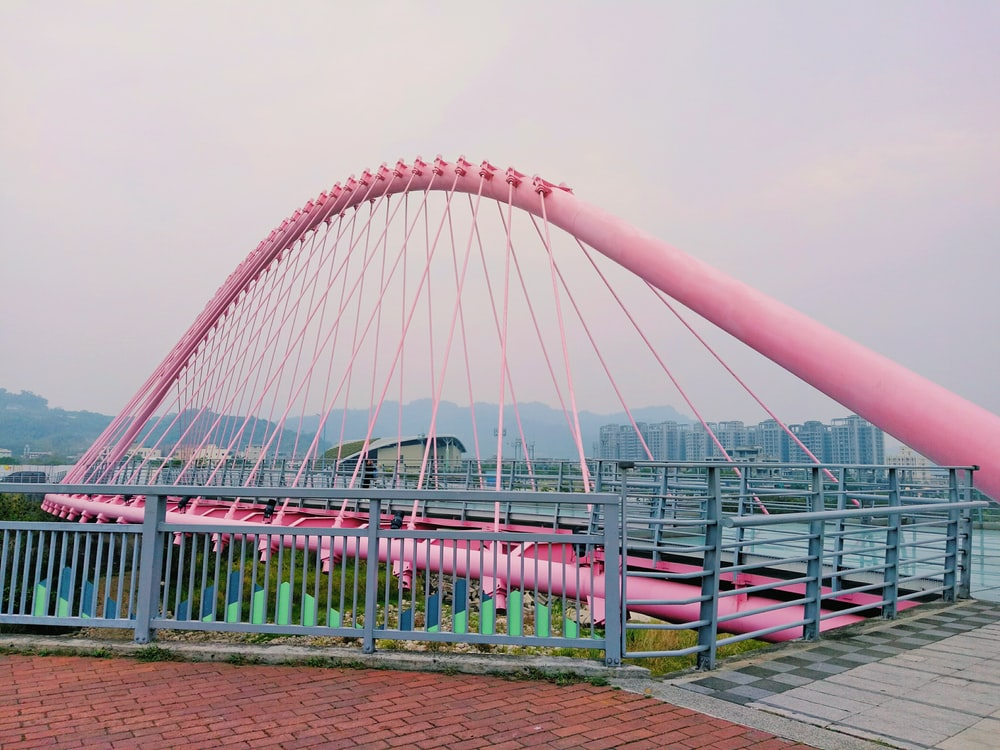 pink suspension bridge illustration