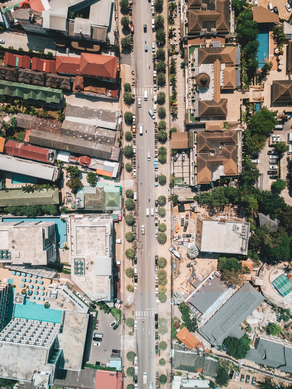 aerial photography of vehicles on road and buildings during daytime