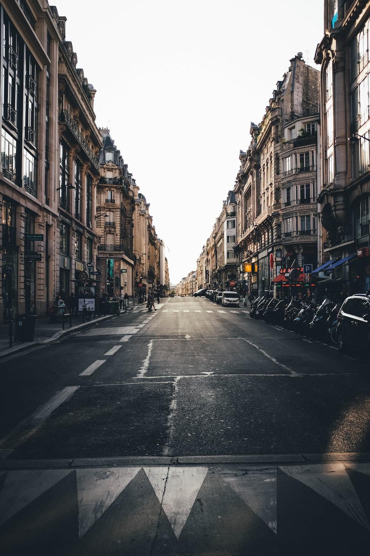 street between brown concrete buildings during daytime