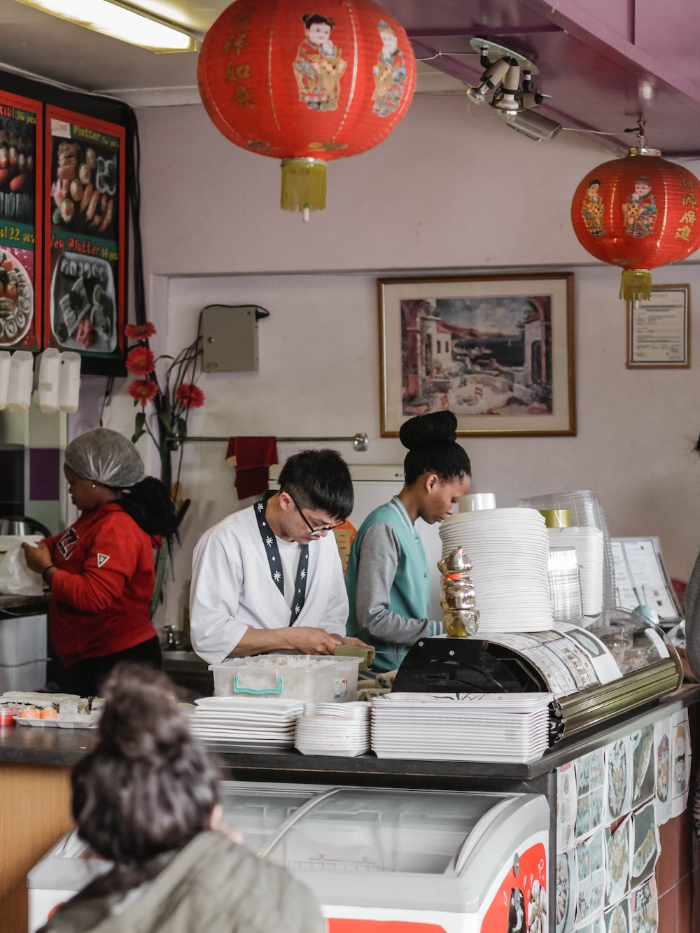 people behind counter table
