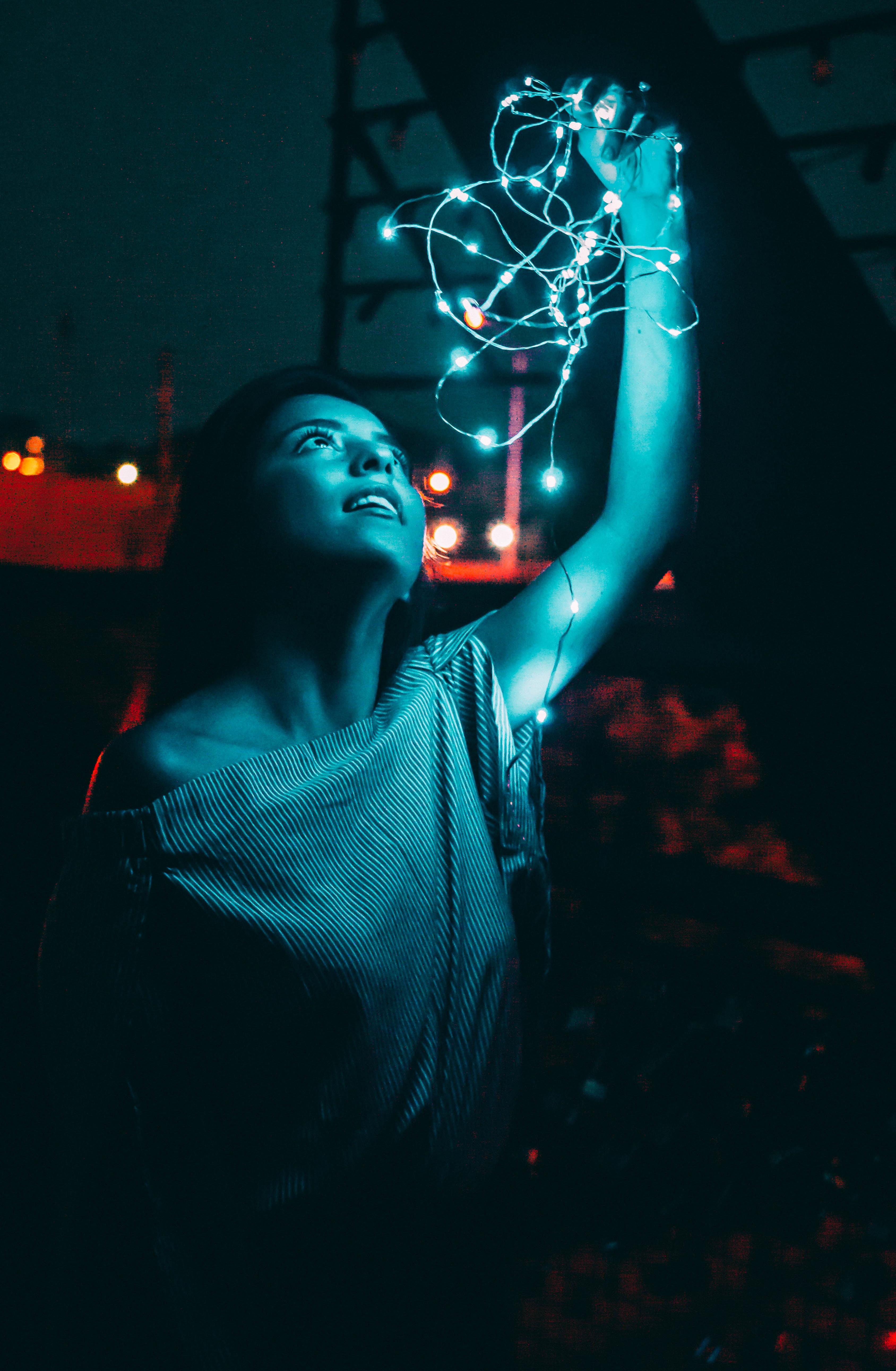 woman holding white string light