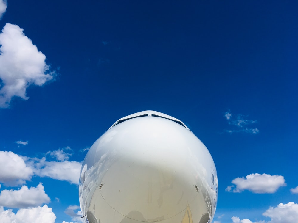 aircraft under blue and white skies