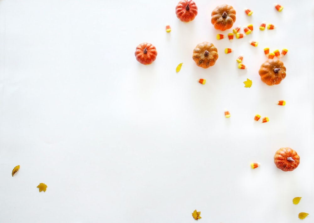 pumpkins on white surface