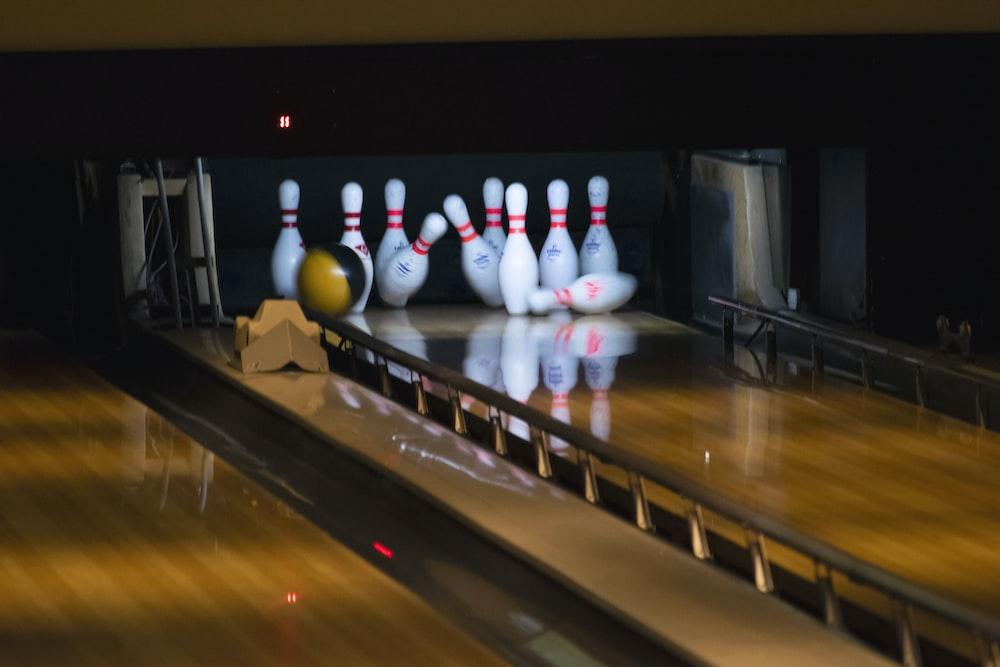 bowling balls hitting pins