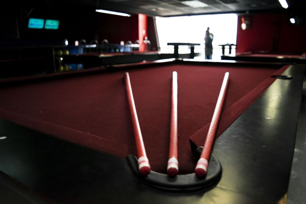 red and black pool table closeup photography