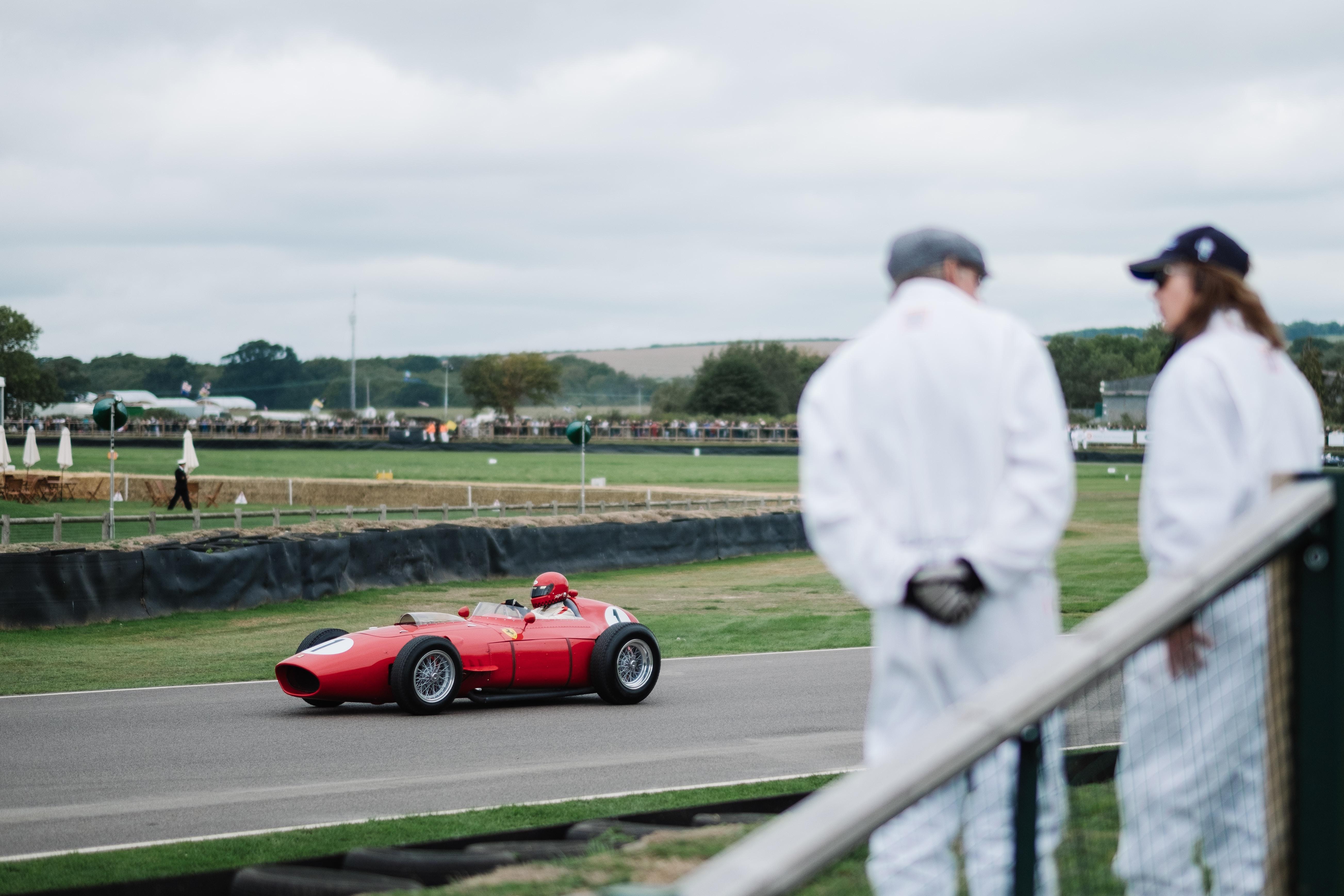person riding racing go-kart between grass field