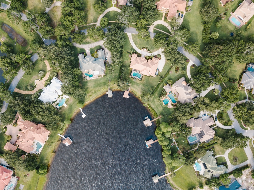 aerial photography of body of water surrounded with buildings