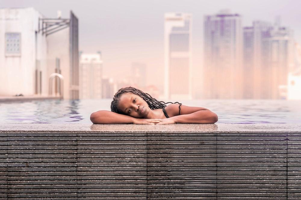 woman on pool under gray sky