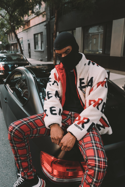 man sitting on car trunk