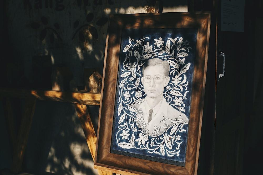 brown wooden framed woman portrait