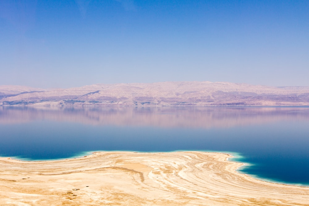 body of water during daytime digital wallpaper