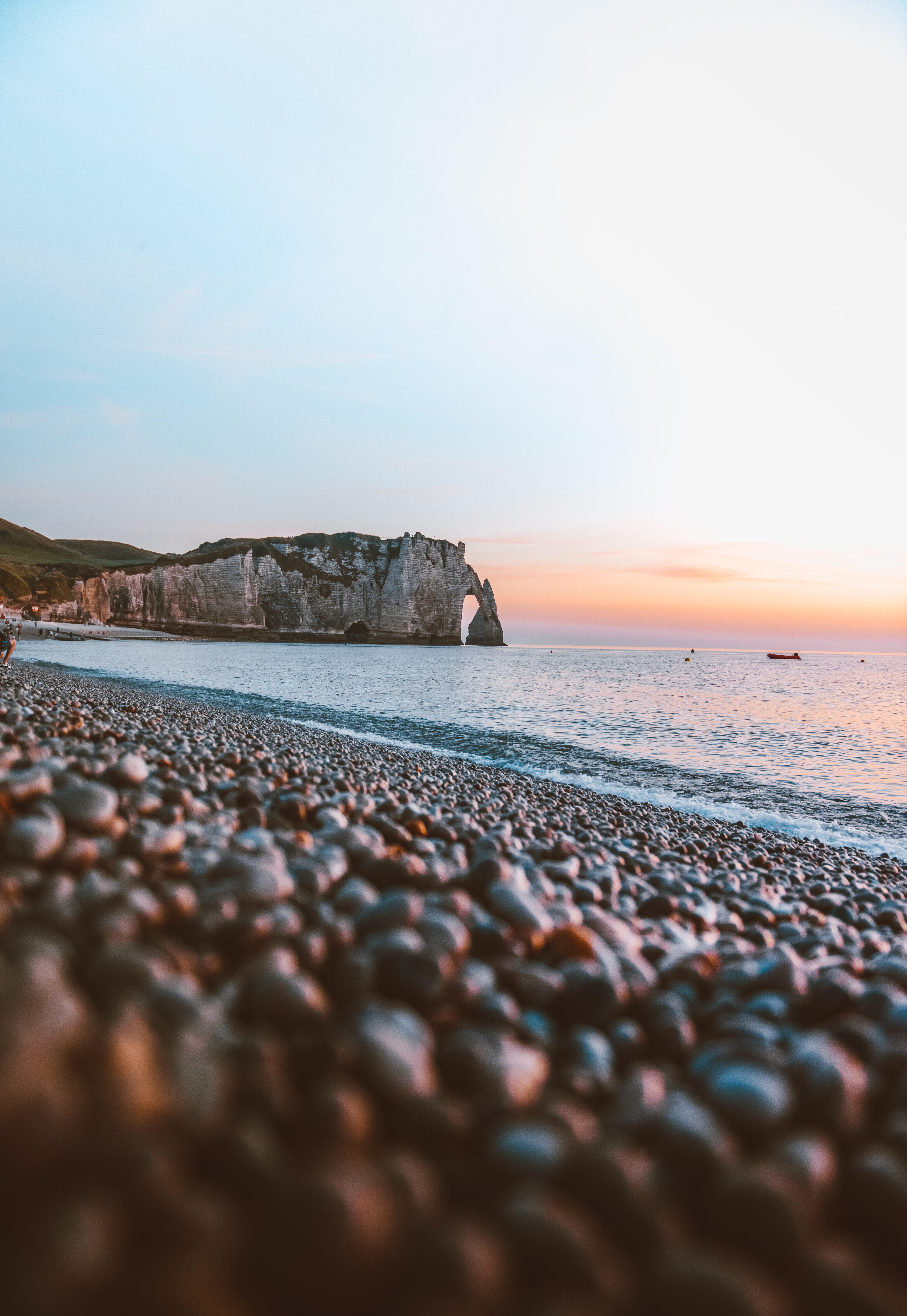 rock formation sea side taken at daytime