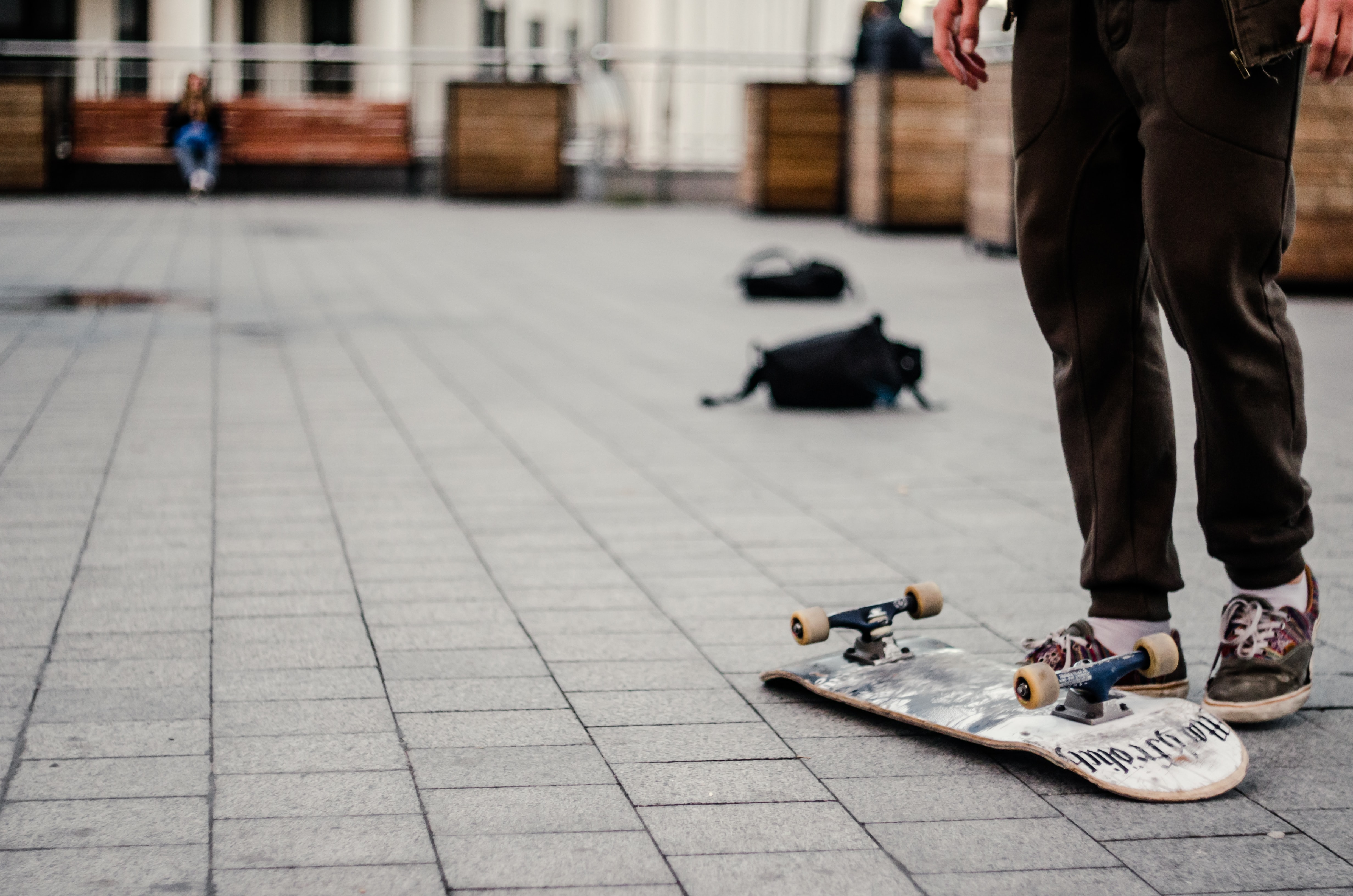 person standing near white and black skateboard