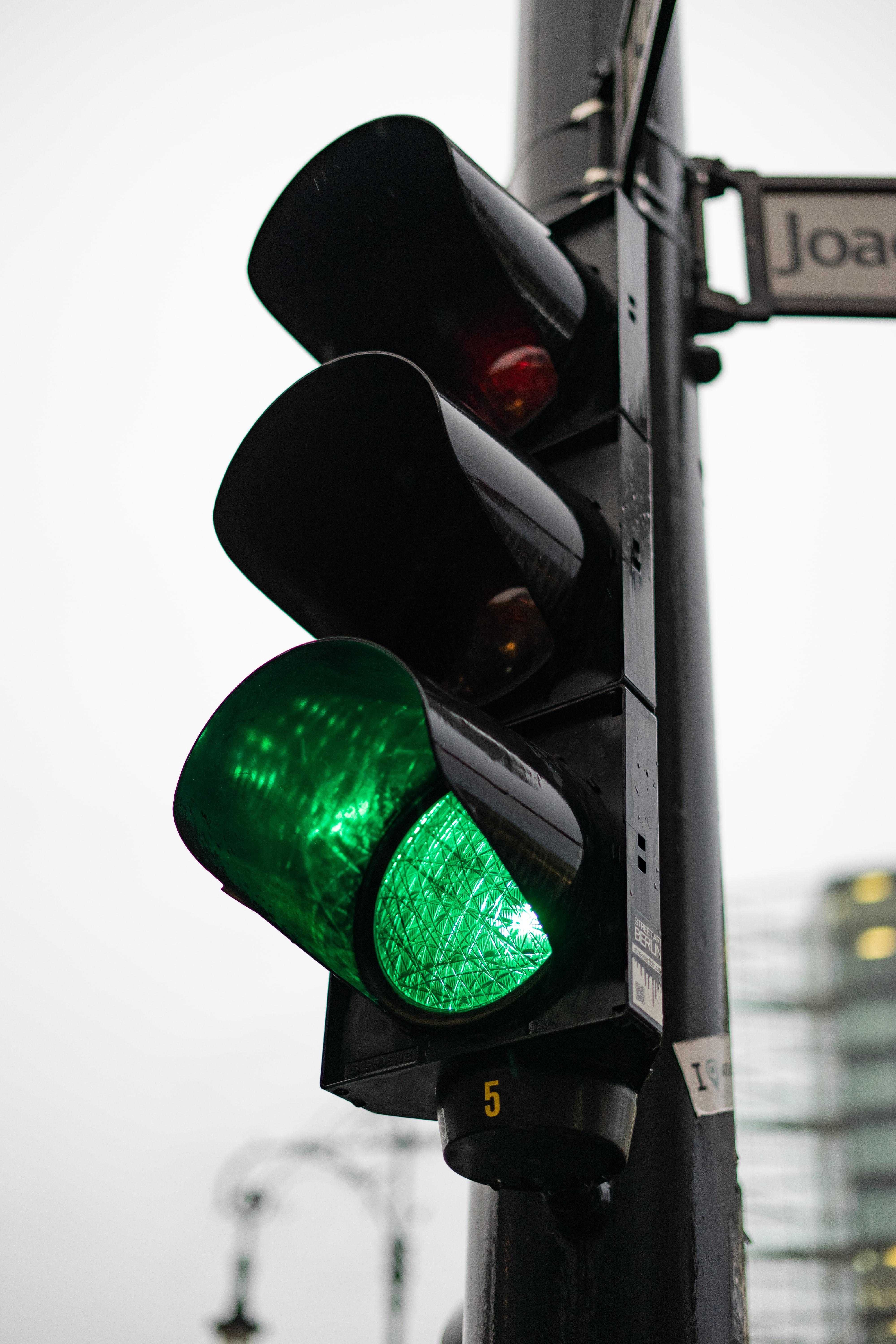 black traffic light on go signal