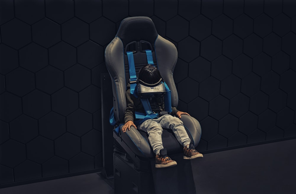toddler sitting on gaming chiar