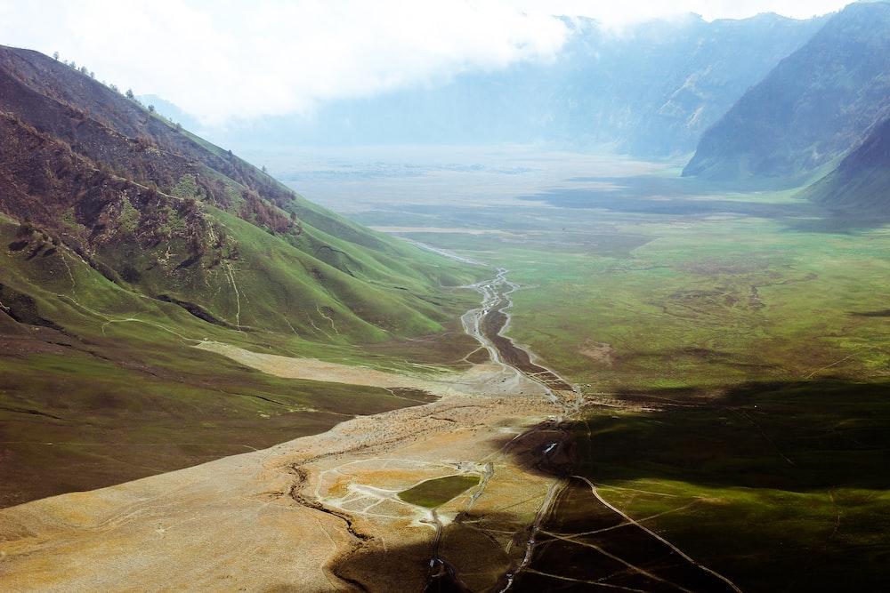 pathway between mountains during daytime