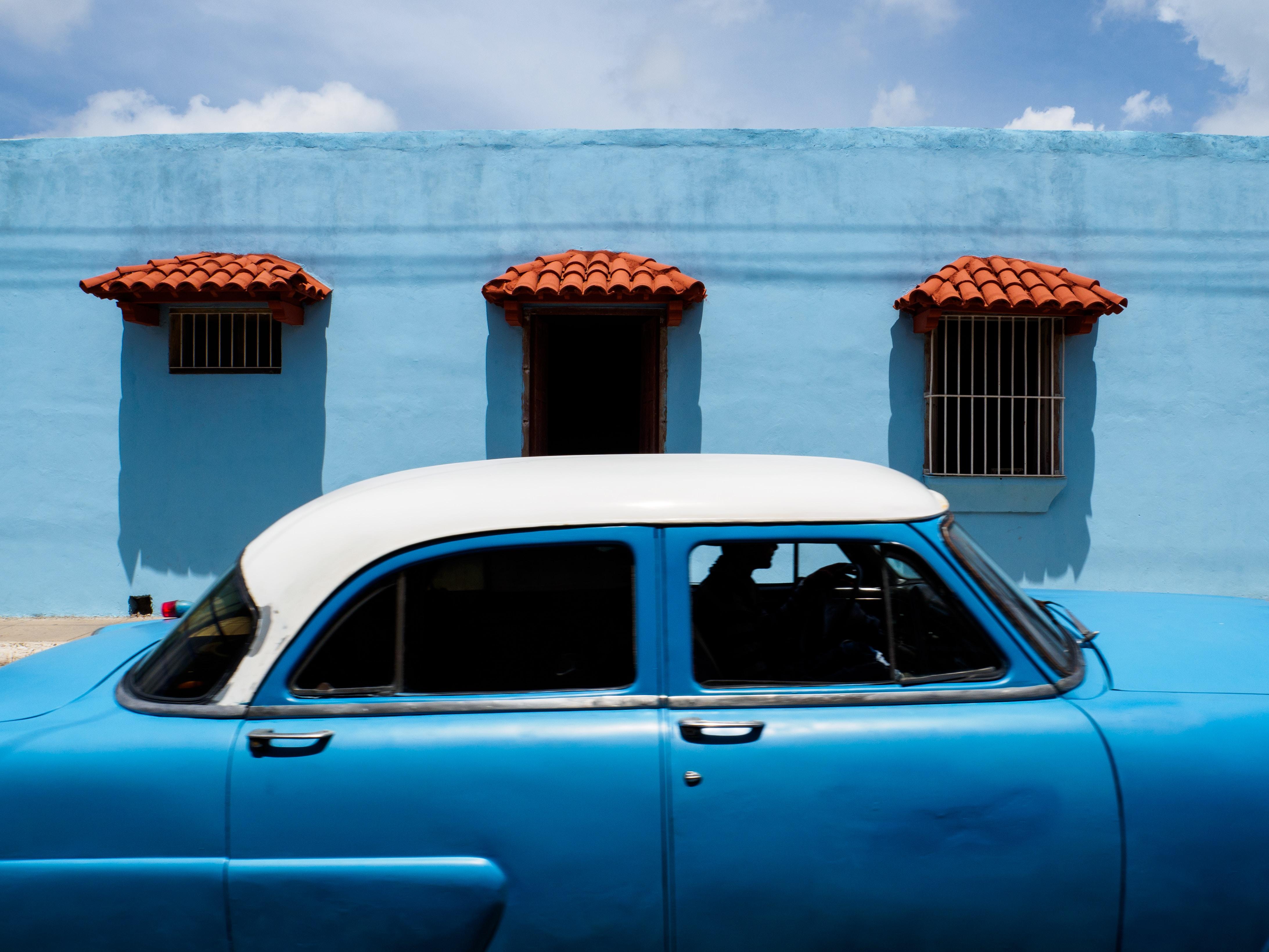 blue and white sedan during daytime