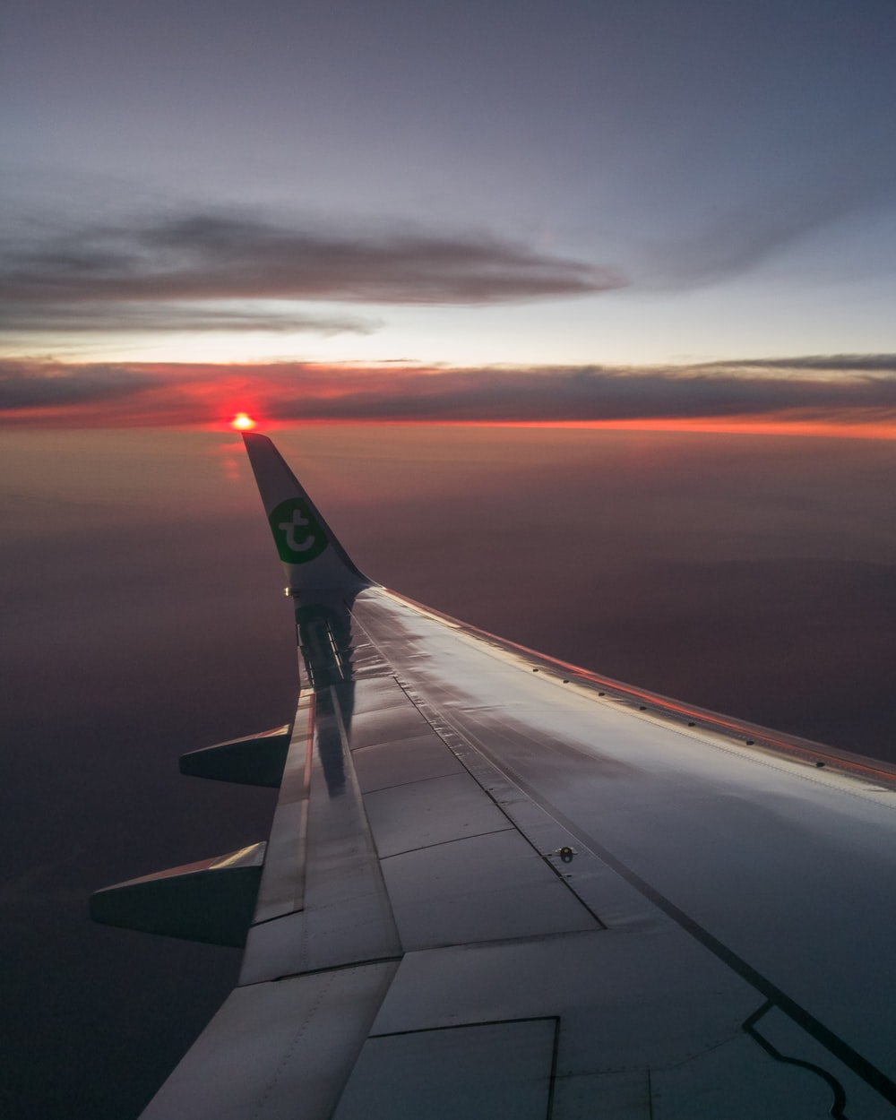 photo of left plane wing during golden hour