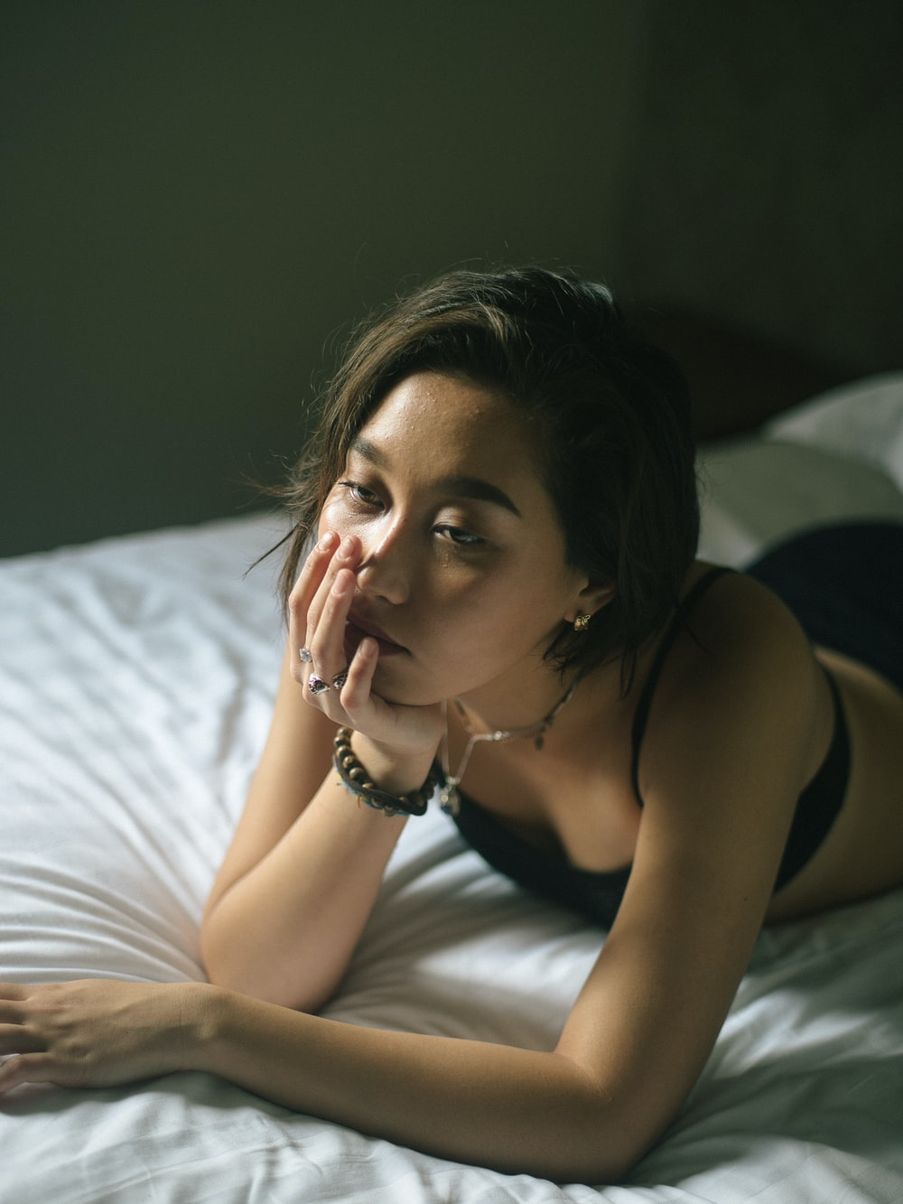woman lying on bed inside room