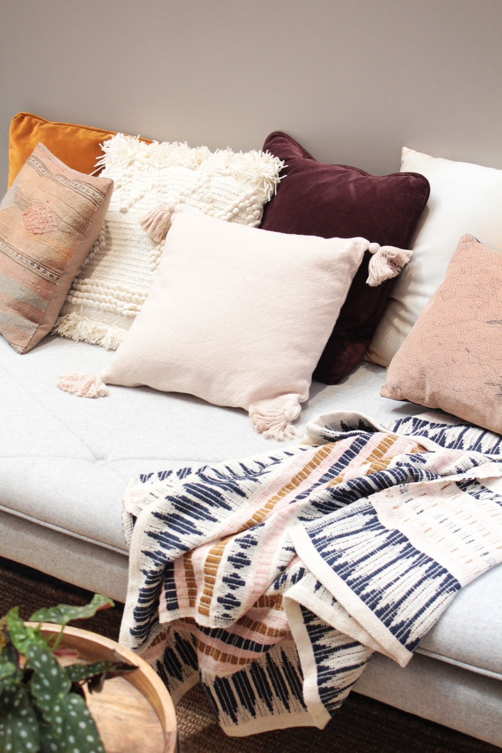 assorted throw pillows on gray couch
