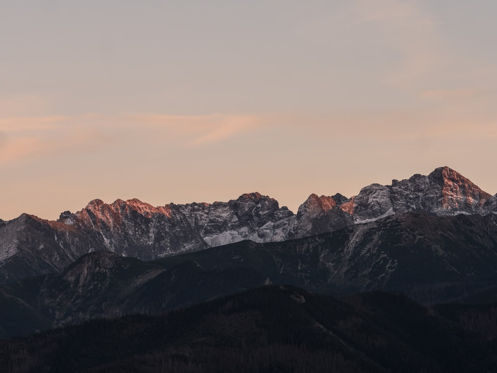 snow-capped mountain during sunset