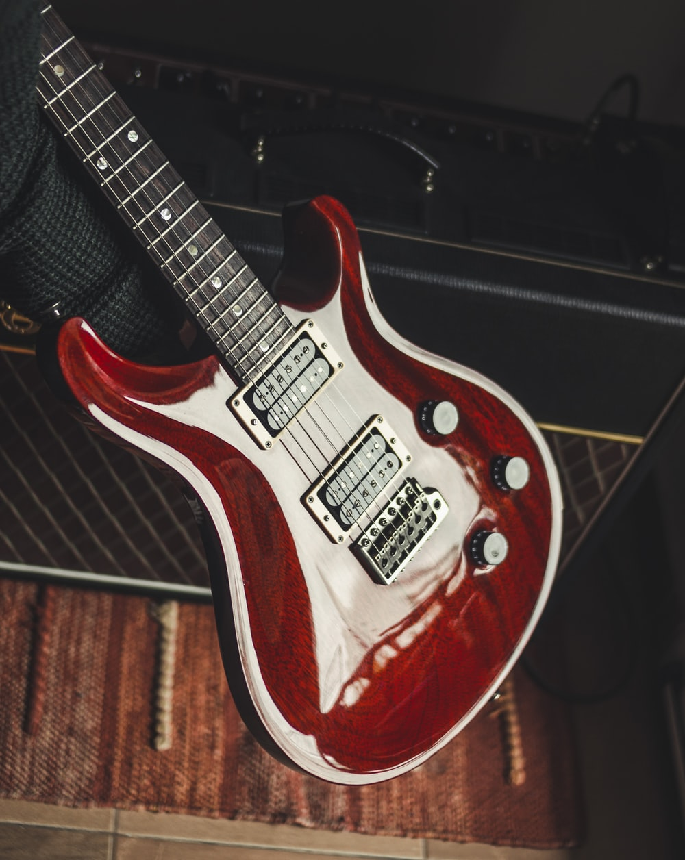 red and white electric guitar