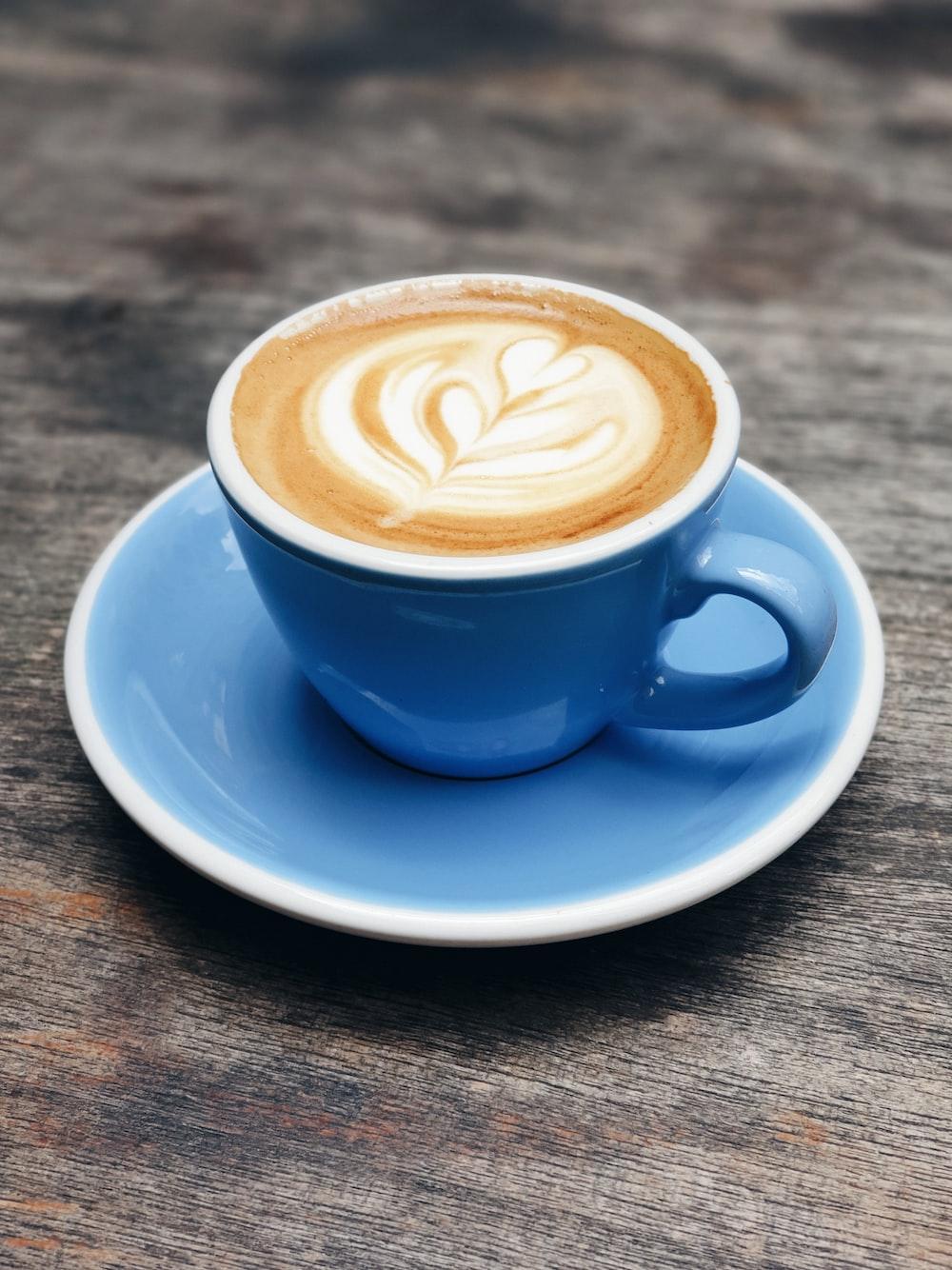 blue ceramic teacup with latte