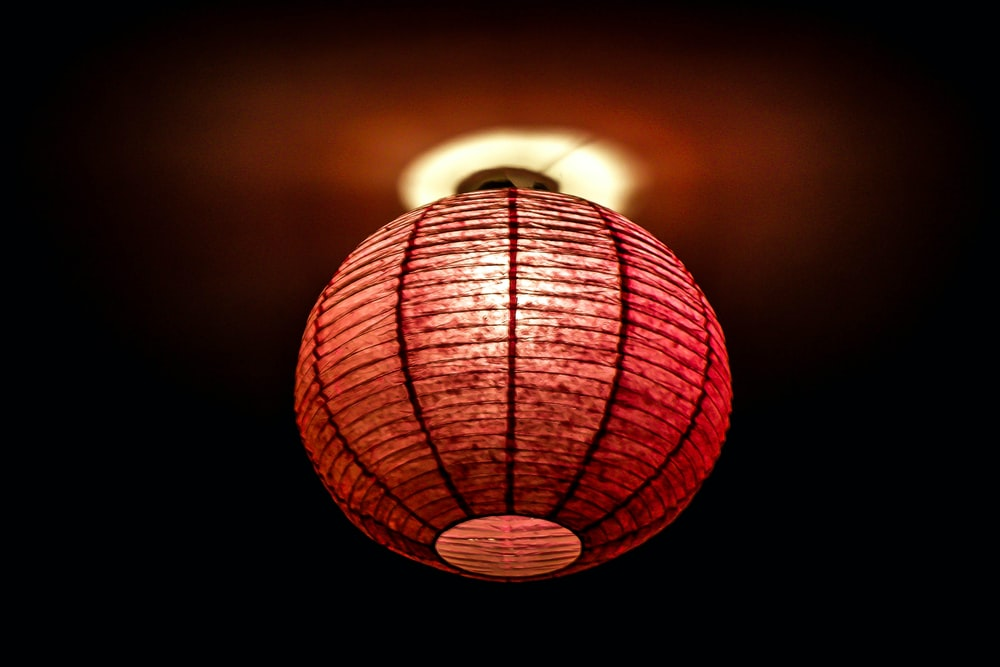 focus photo of red lamp