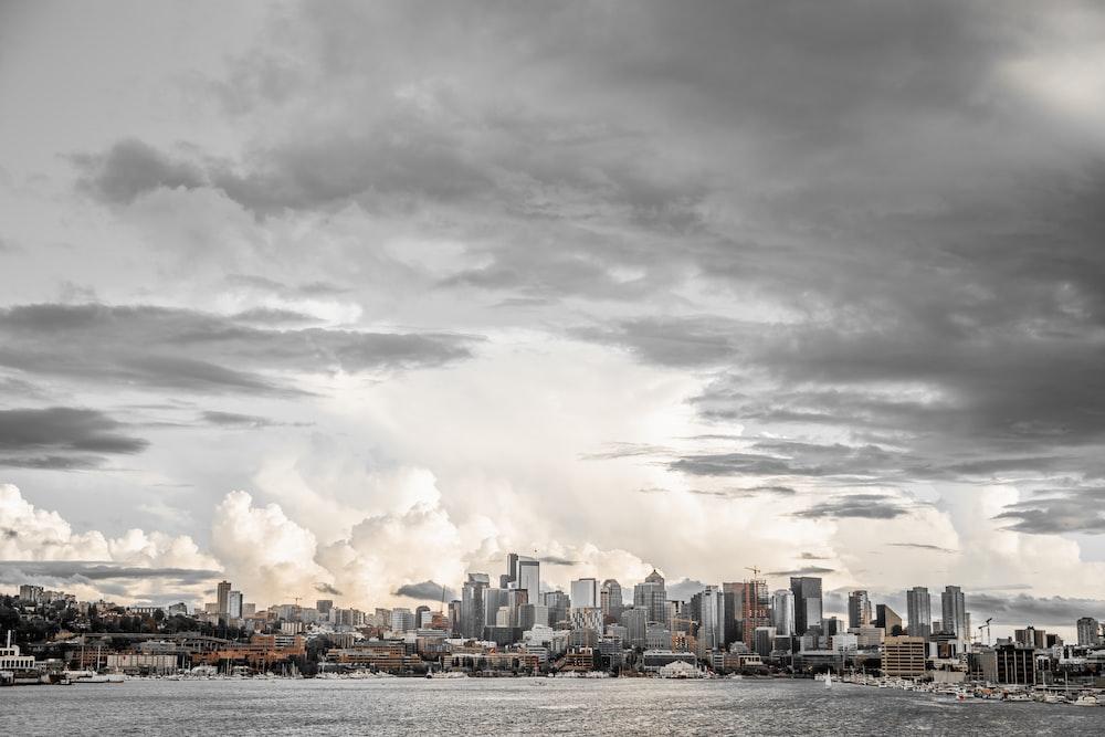 city buildings under gray cloudy sky